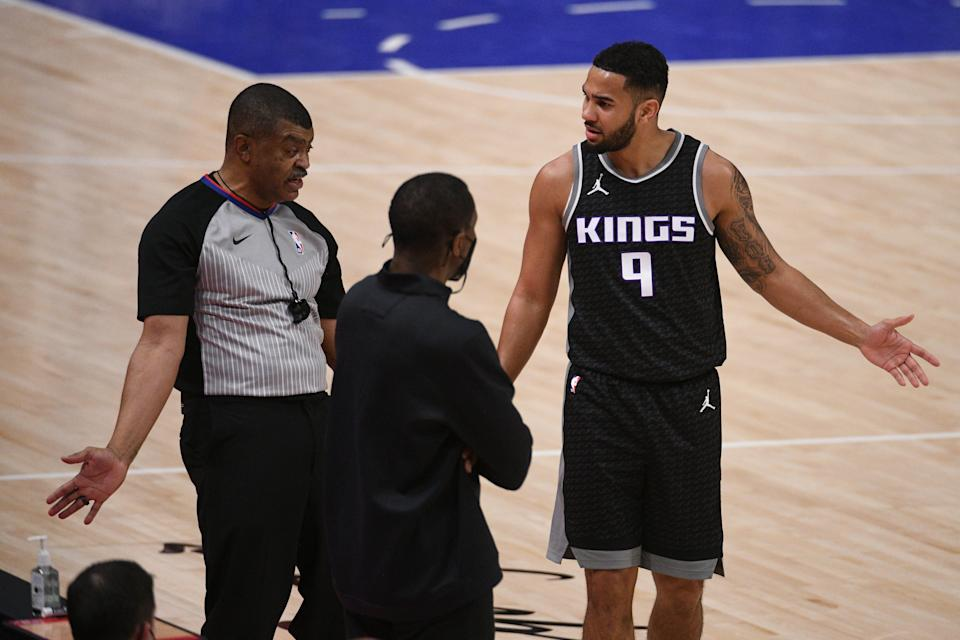 Kings guard Cory Joseph argues with a ref as Pistons coach Dwane Casey listens Feb. 26, 2021 in Detroit.