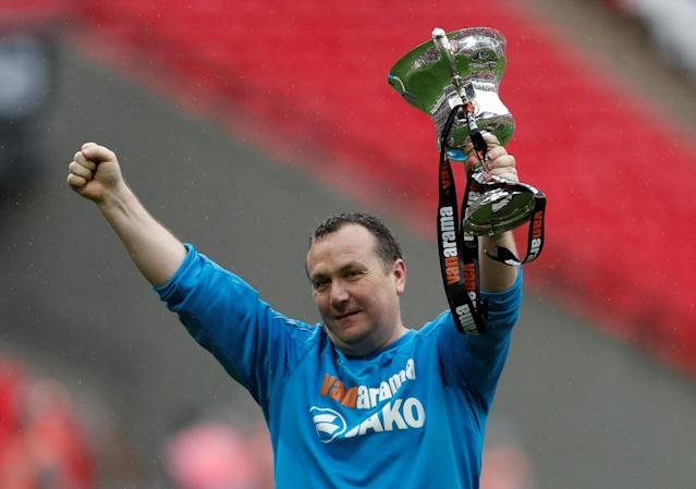 Soccer Football - National League Promotion Final - Tranmere Rovers v Boreham Wood - Wembley Stadium, London, Britain - May 12, 2018 Tranmere Rovers' manager Micky Mellon celebrates with the trophy after the match Action Images/Matthew Childs