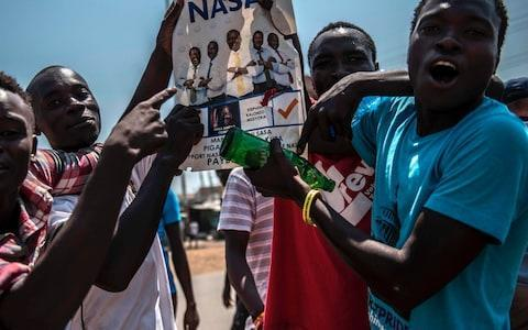 <span>Supporters of Kenyan Opposition leader Raila Odinga shout and gesture during a protest at Kondele on August 9, 2017 in Kisumu, Kenya</span> <span>Credit: AFP </span>