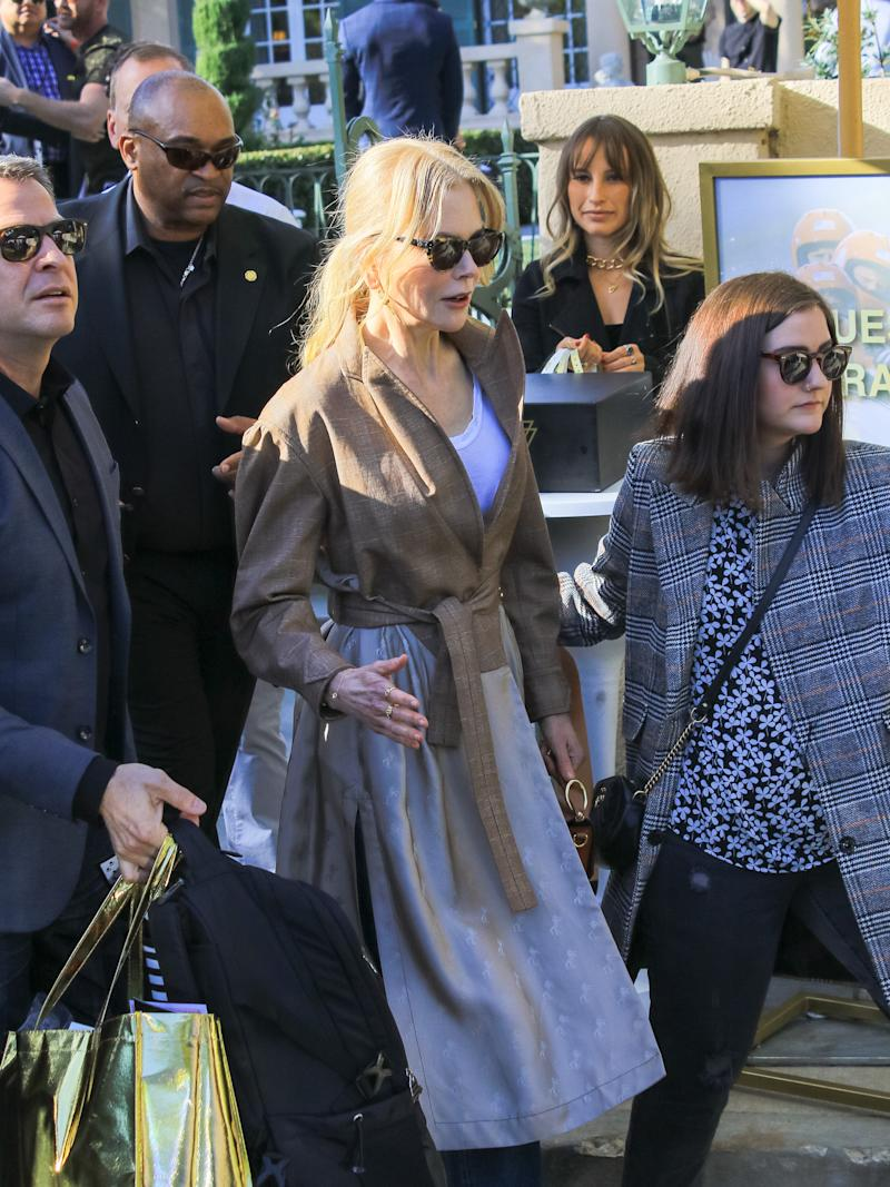 Nicole Kidman in trench coat and black sunglasses at pre Golden Globes event