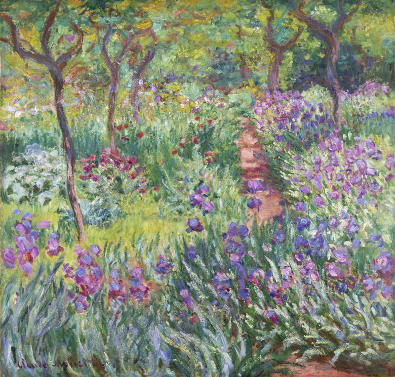 """This undated photo provided by the New York Botanical Garden shows Claude Monet's painting, """"The Artist's Garden in Giverny,"""" which is on display in a new exhibition at the New York Botanical Garden, in New York. Monet once said he owed becoming a painter to his love for flowers and the exhibit explores the French impressionist artist's passion for his beloved water lilies, irises and gardens and how they influenced his art. (AP Photo/New York Botanical Garden)"""