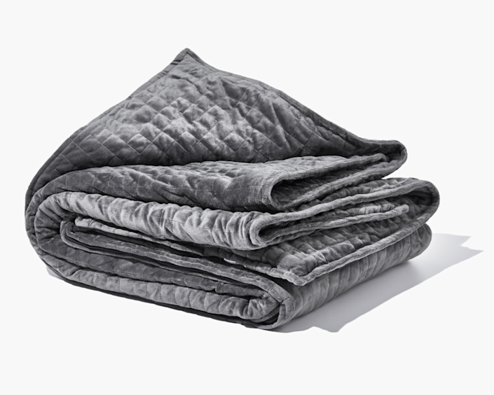 """If he's prone to sleepless nights, this comforting weighted blanket might help him rest easy until morning while also reducing his stress and anxiety. $195, Gravity. <a href=""""https://gravityblankets.com/products/gravity-blanket"""" rel=""""nofollow noopener"""" target=""""_blank"""" data-ylk=""""slk:Get it now!"""" class=""""link rapid-noclick-resp"""">Get it now!</a>"""