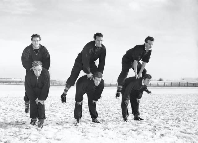 Jimmy Mullen (left, leaping) trains in the snow with Wolves team-mates (PA Archive)