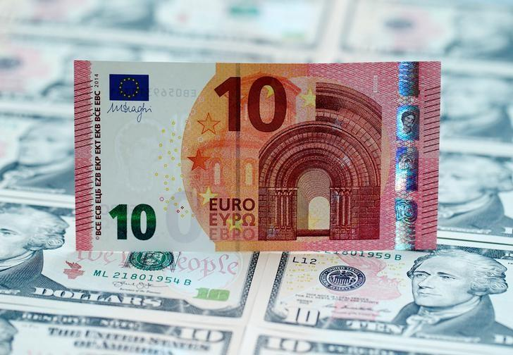 U.S. dollar and euro banknotes are seen in this picture illustration, March 16, 2015. REUTERS/Heinz-Peter Bader/Illustration/File Photo