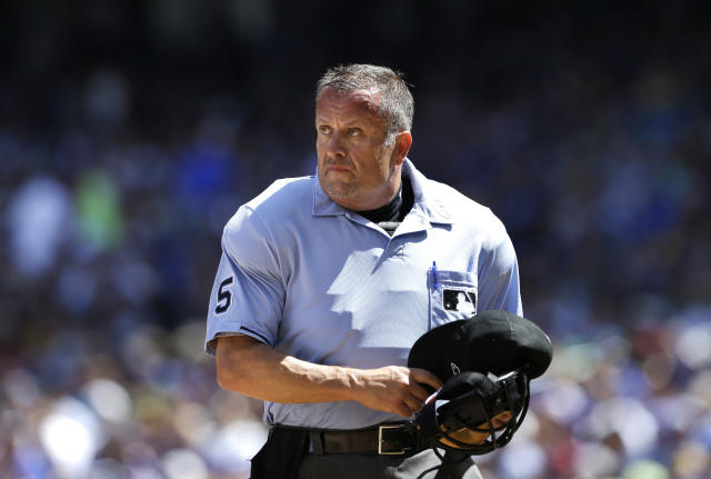 After over 30 years and over 3,500 games, umpire Dale Scott is retiring due to his concerns about concussions. (AP Photo)
