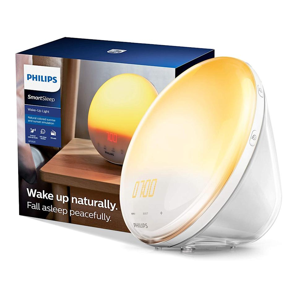 """<p><strong>Philips SmartSleep</strong></p><p>amazon.com</p><p><strong>$99.99</strong></p><p><a href=""""https://www.amazon.com/dp/B0093162RM?tag=syn-yahoo-20&ascsubtag=%5Bartid%7C10060.g.36327760%5Bsrc%7Cyahoo-us"""" rel=""""nofollow noopener"""" target=""""_blank"""" data-ylk=""""slk:Shop Now"""" class=""""link rapid-noclick-resp"""">Shop Now</a></p><p>If you want something that looks like a mini rising and setting sun on your nightstand, this alarm clock is the closest you'll get to the real deal. It features a round convex face and a spot-on color gradient that ranges from pale yellow to a mellow orange-red. </p><p>It's made by Philips, a company that's long specialized in lighting (founded in 1891, in fact) and features 10 brightness settings and five alarm sounds, plus an FM radio and an auto-dimmable display. Sunrise can be set to elapse in 20 or 40 minutes, and there's a snooze button for mornings when you choose to ignore the pseudo rising sun and pull the covers over your head.</p>"""