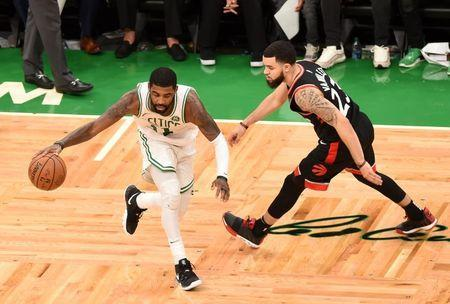 Nov 16, 2018; Boston, MA, USA; Boston Celtics guard Kyrie Irving (11) controls the ball against Toronto Raptors guard Fred VanVleet (23) during overtime at TD Garden. Bob DeChiara-USA TODAY Sports