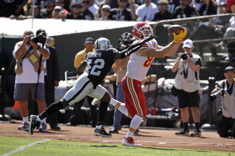 Kansas City Chiefs tight end Travis Kelce scores a touchdown as Oakland Raiders free safety Karl Joseph looks on during the first half of an NFL football game Sunday, Sept. 15, 2019, in Oakland, Calif. (AP Photo/Ben Margot)