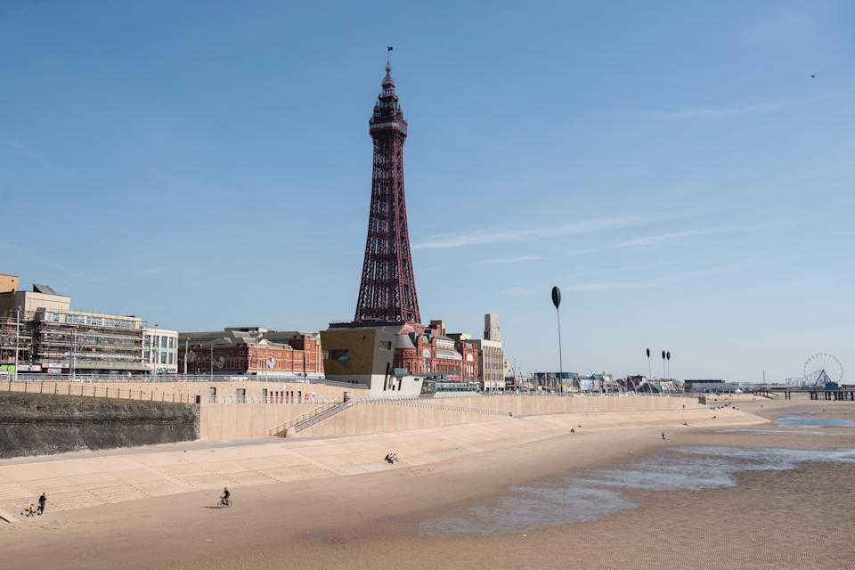 The Blackpool Tower, an iconic British landmark and tourist attraction, is pictured on the 125th anniversary of the tower's opening to the public, in Blackpool, northern England on May 14, 2019. - The tower, which took 3 years to construct and opened in 1894, was inspired by the Eiffel Tower which had opened 5 years earlier. The entertainment complex at the base of the tower comprises a ballroom, circus, aquarium, adventure playground and restaurant. It stands at 158m tall making it the 120th tallest freestanding tower in the world. (Photo by OLI SCARFF / AFP)        (Photo credit should read OLI SCARFF/AFP via Getty Images)