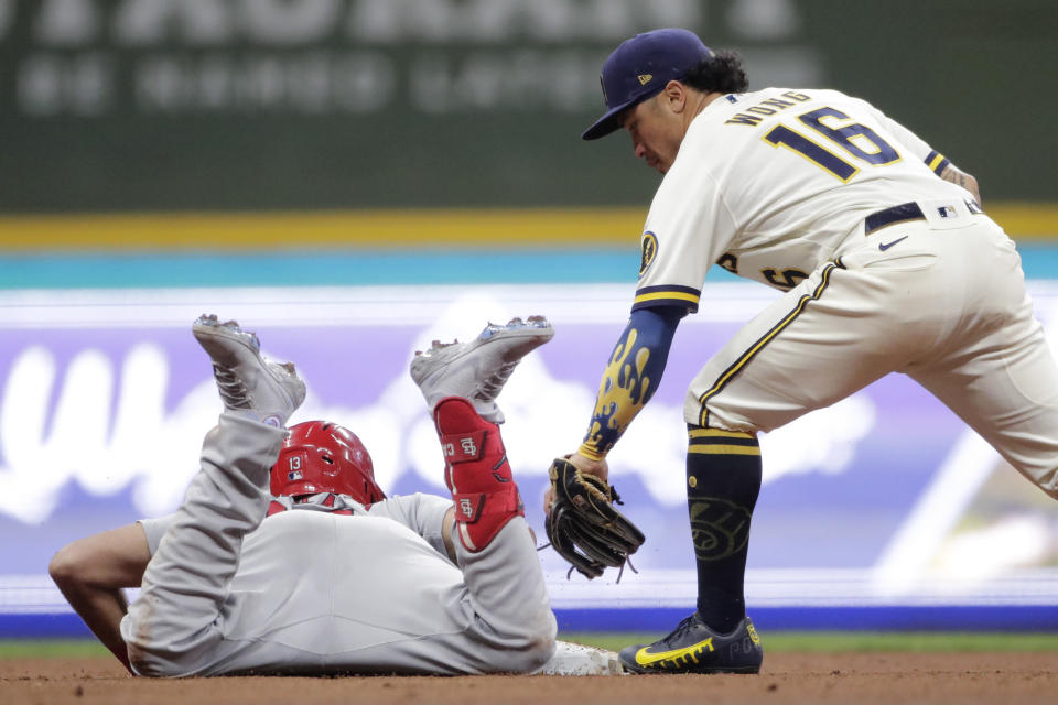 St. Louis Cardinals' Matt Carpenter, left, slides safely into second base for a double past the tag of Milwaukee Brewers' Kolten Wong (16) during the seventh inning of a baseball game Monday, Sept. 20, 2021, in Milwaukee. (AP Photo/Aaron Gash)