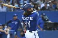 Toronto Blue Jays' Bo Bichette watches his two-run home run against the Cleveland Indians during the fourth inning of a baseball game Thursday, Aug. 5, 2021, in Toronto. (Jon Blacker/The Canadian Press via AP)