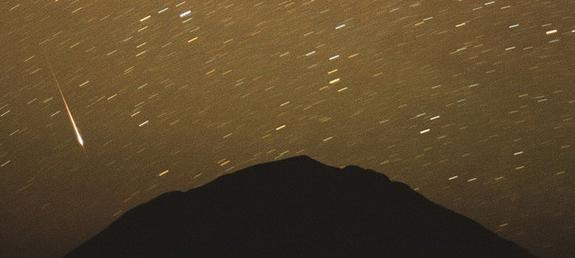 Photographer Chris Gruhusko captured this view of the Leonid meteor shower in November 2001 over the north face of Wind Mountain in the Cornudas Mountain of Southern New Mexico.
