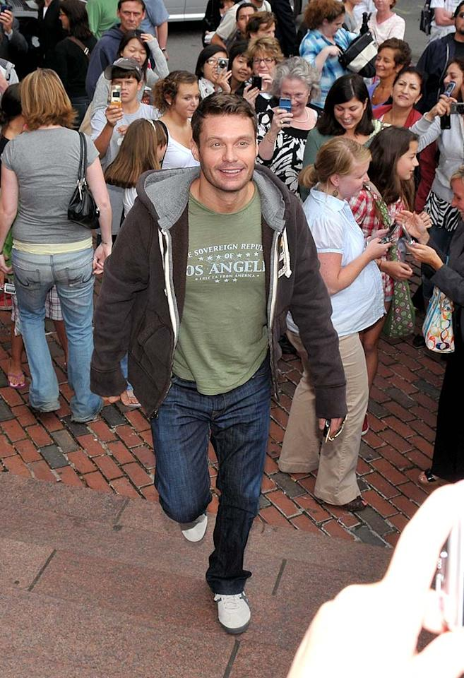 "Ryan Seacrest is all smiles upon arriving in Boston for ""American Idol"" auditions ... sans Paula Abdul. Shane Conway/<a href=""http://www.splashnewsonline.com"" target=""new"">Splash News</a> - August 13, 2009"
