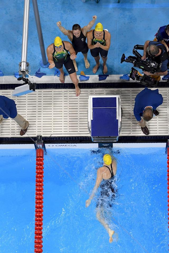 <p>Emma McKeon, Brittany Elmslie, Bronte Campbell and Cate Campbell of Australia celebrate winning gold and a new world record in the Final of the Women's 4 x 100m Freestyle Relay on Day 1 of the Rio 2016 Olympic Games at the Olympic Aquatics Stadium on August 6, 2016 in Rio de Janeiro, Brazil. (Photo by Richard Heathcote/Getty Images) </p>