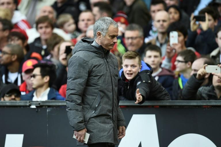 Manchester United's Jose Mourinho leaves the pitch at half-time during their match against West Bromwich Albion at Old Trafford in Manchester, north west England, on April 1, 2017