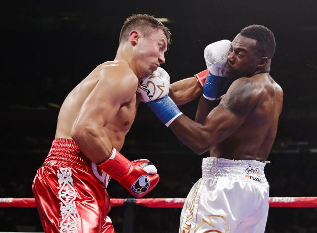 Kazakhstan's Gennady Golovkin, left, exchanges punches with Canada's Steve Rolls during the second round of a super middleweight boxing match Saturday, June 8, 2019, in New York. Golovkin won in the fourth round. (AP Photo/Frank Franklin II)