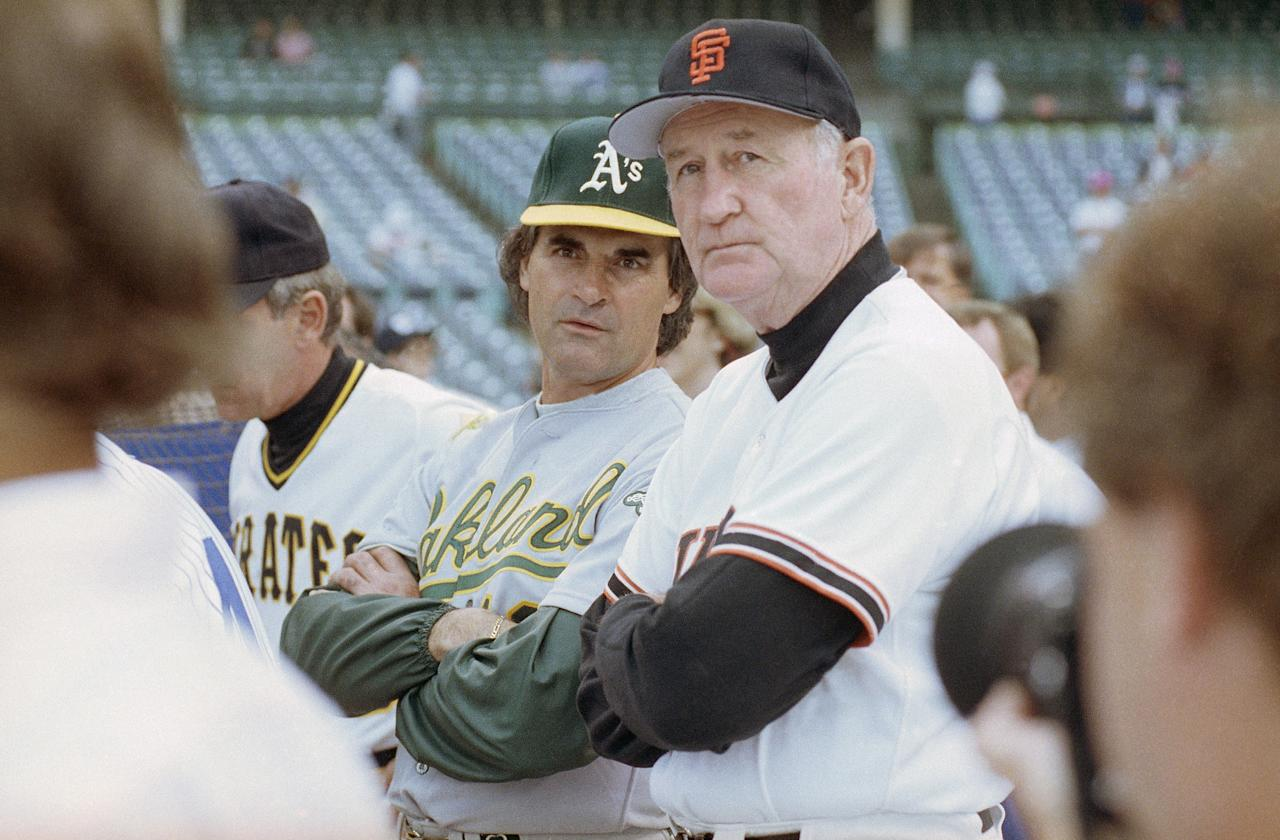 American League manager Tony La Russa, left, from the Oakland A's and National League manager Roger Craig of the San Francisco Giants watch batting practice together, Tuesday, July 10, 1990, before the start of the 61st All Star Game at Wrigley field in Chicago. (AP Photo/Robert Kozloff)