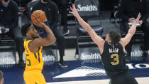 Utah Jazz guard Donovan Mitchell (45) shoots as Memphis Grizzlies guard Grayson Allen (3) defends in the first half during an NBA basketball game Saturday, March 27, 2021, in Salt Lake City. (AP Photo/Rick Bowmer)
