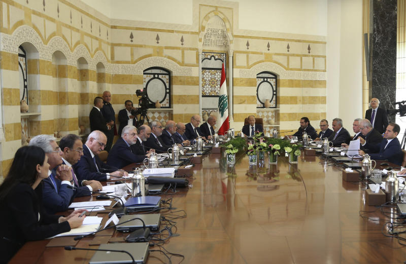 """In this photo released by Lebanon's official government photographer Dalati Nohra, Lebanese President Michel Aoun, center, meets with political leaders with the aim of finding solutions to the country's economic crisis, in the presidential palace, in Baabda, east of Beirut, Lebanon, Monday, Sept. 2, 2019. Aoun said in a speech at the opening of the one-day session that everyone should make """"sacrifices"""" in order to get one of the world's most indebted countries out of its problems. (Dalati Nohra via AP)"""