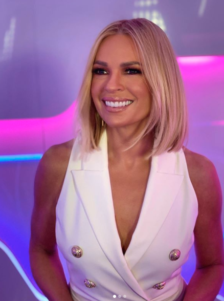 Sonia Kruger in a white outfit on Big Brother