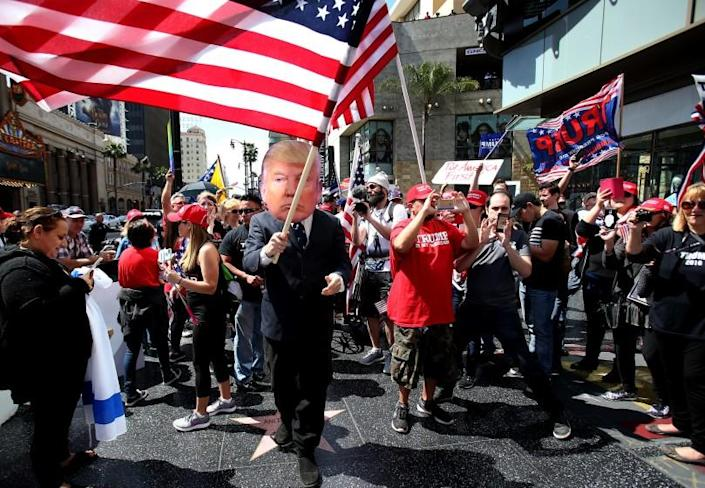 Trump supporters march in the Make America Great Again rally on Hollywood Boulevard.