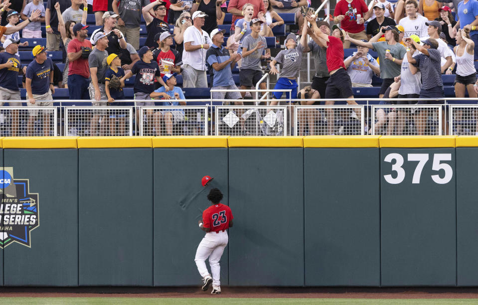 Arizona's Donta Williams (23) watches as a two-run home run hit by Vanderbilt's Jayson Gonzalez in the fourth inning during a baseball game in the College World Series, Saturday, June 19, 2021, at TD Ameritrade Park in Omaha, Neb. (AP Photo/Rebecca S. Gratz)