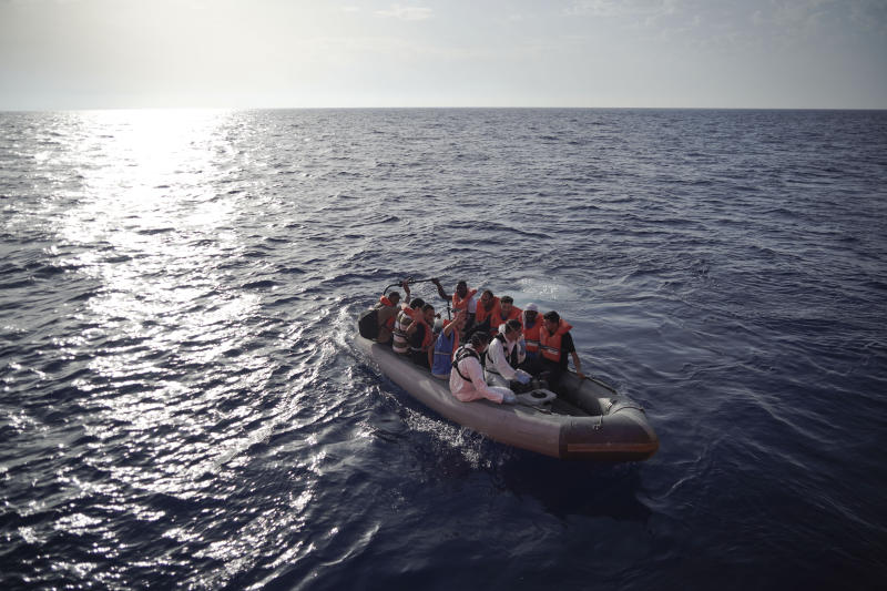 Members of the Maltese Armed Forces take a group of migrants to a Maltese military ship in the Mediterranean Sea, Friday, Sept. 20, 2019. Malta has agreed to take in 35 migrants fleeing Libya who were rescued by the Ocean Viking humanitarian ship a day earlier.(AP Photo/Renata Brito)