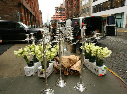 The flowers, which were delivered curbside in a truly amateur move, were one of the indications that Jay and Bey's wedding was imminent. (Photo: Splash News)