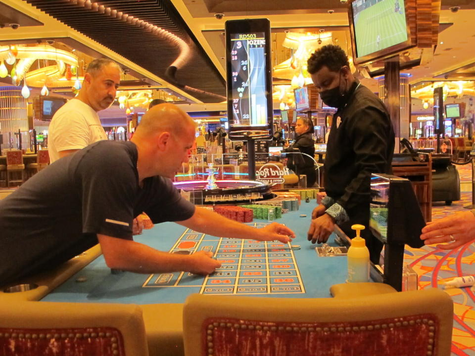 People play at the Hard Rock casino in Atlantic City N.J., on Monday, June 28, 2021. Hard Rock last year finished second only to the Borgata in terms of money won from in-person gamblers. (AP Photo/Wayne Parry)