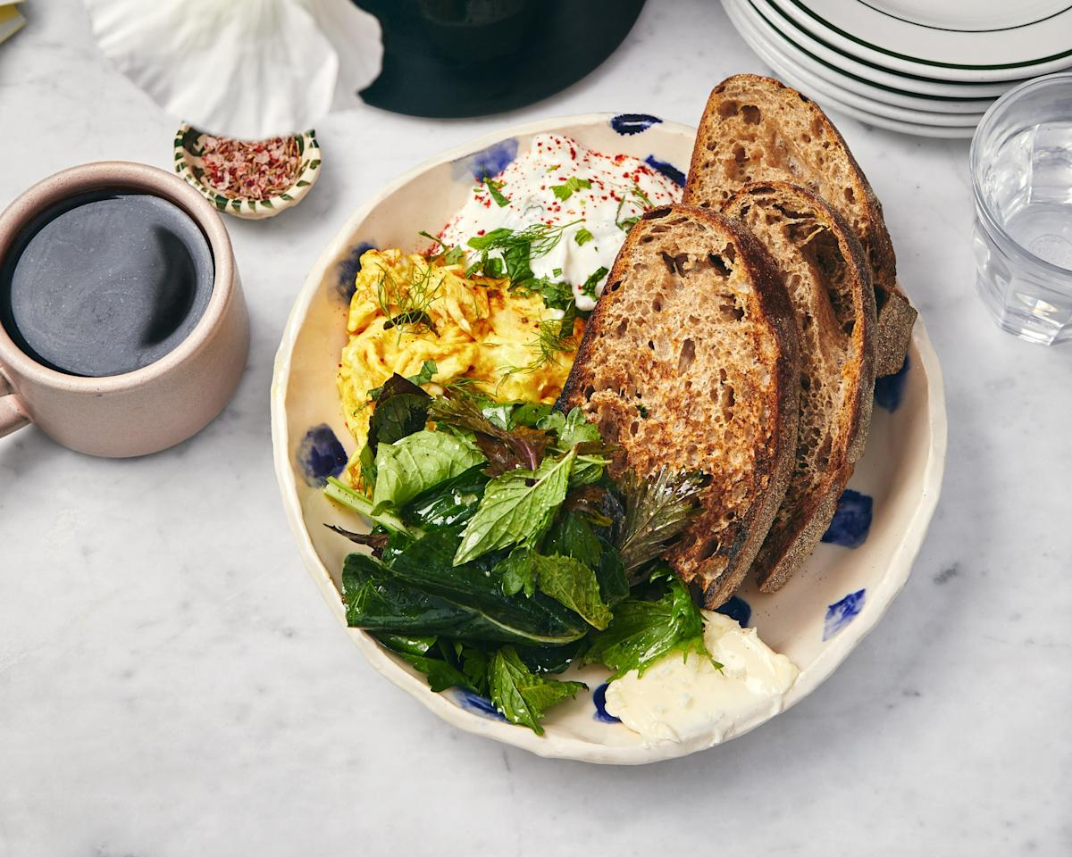 """We can't call these just scrambled eggs. At <a href=""""https://www.bonappetit.com/story/hot-10-best-new-restaurants-2019?mbid=synd_yahoo_rss#ochre"""">Ochre Bakery in Detroit</a>, No. 4 on our Hot Ten list in 2019, they soft scramble eggs with turmeric and serve them with tzatziki; a big pile of greens; a very generous serving of very good butter; two holey slices of country bread; and a tiny bowl of cumin seeds, Aleppo-style pepper, and flaky sea salt. A quick word to the wise: Preground curry powder can go musty quickly. If your jar isn't fresh, replace it for the sake of these buttery, fast-scrambled eggs. <a href=""""https://www.bonappetit.com/recipe/spiced-eggs-with-tzatziki?mbid=synd_yahoo_rss"""">See recipe.</a>"""