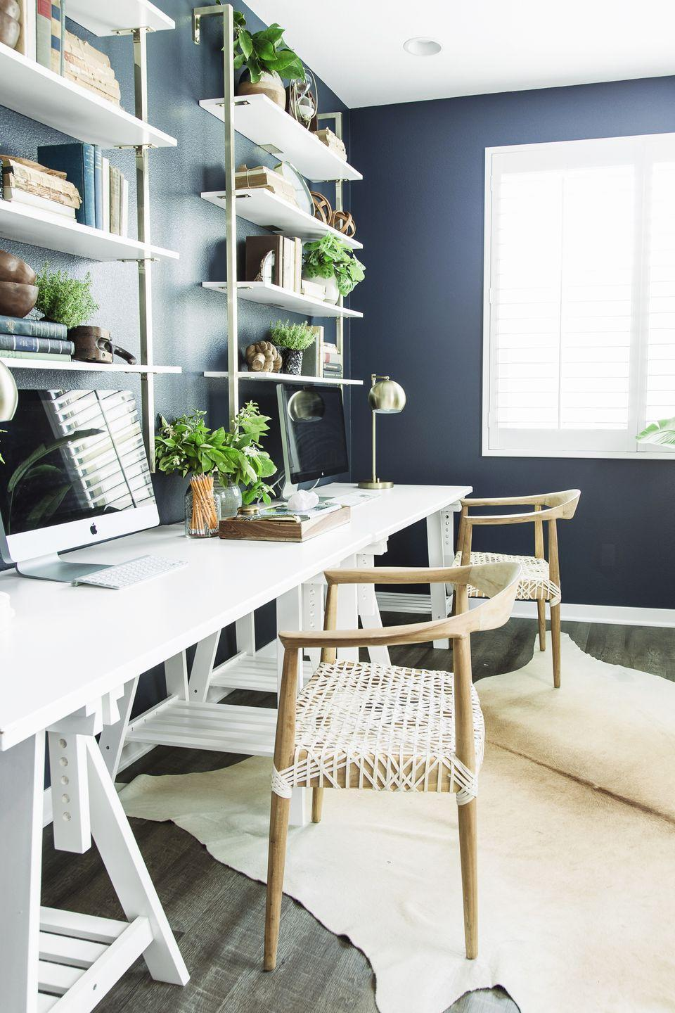 """<p>Rely on Mother Nature to give your office new life. Scatter succulents and plants — real or fake — on shelves and reap the benefits, especially if you choose <a href=""""https://www.goodhousekeeping.com/home/gardening/a32552/houseplants-that-purify-air/"""" rel=""""nofollow noopener"""" target=""""_blank"""" data-ylk=""""slk:air-purifying varieties like spider and snake plants."""" class=""""link rapid-noclick-resp"""">air-purifying varieties like spider and snake plants. </a></p>"""