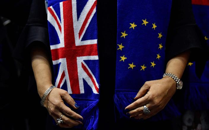 European Union and the Union Jack flags -  JOHN THYS/ AFP