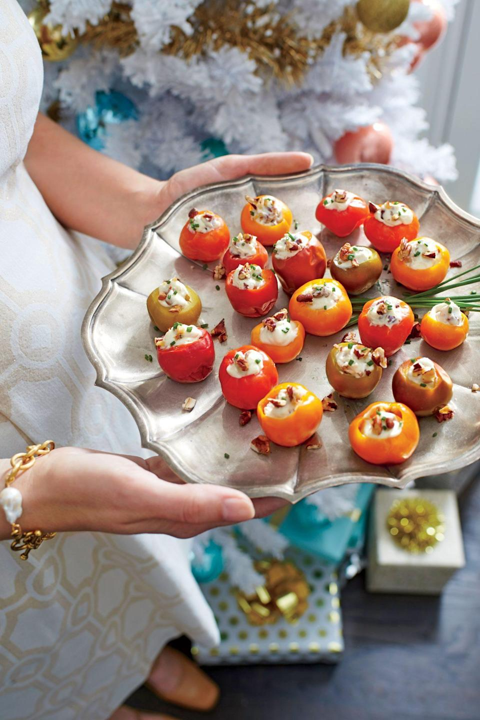 """<p><strong>Recipe: <a href=""""https://www.southernliving.com/recipes/blue-cheese-and-pecan-stuffed-cherry-peppers-recipe"""" rel=""""nofollow noopener"""" target=""""_blank"""" data-ylk=""""slk:Blue Cheese-and-Pecan Stuffed Cherry Peppers"""" class=""""link rapid-noclick-resp"""">Blue Cheese-and-Pecan Stuffed Cherry Peppers</a></strong></p> <p>Pickled cherry peppers are sold in jars with the stems and seeds already removed. <strong><br></strong></p>"""