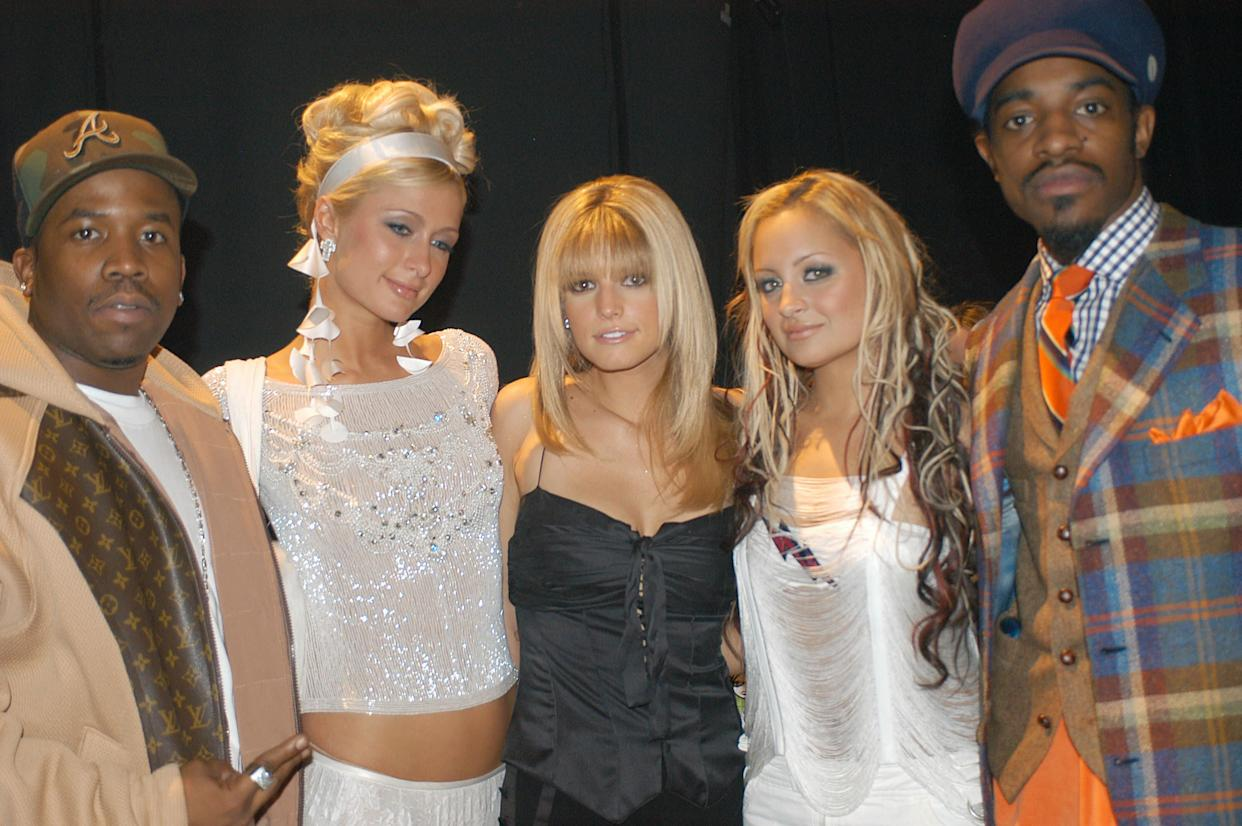 """Paris Hilton with fellow socialite, Nicole Richie (second from right) and (from left) """"self-made"""" musicians Big Boi, Jessica Simpson andAndré 3000 at the 2003 Billboard Music Awards. (Photo: Denise Truscello via Getty Images)"""