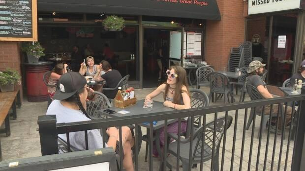 Customers enjoy drinks on a Calgary patio. As of Thursday, indoor dining is allowed in Alberta. (Dave Gilson/CBC - image credit)