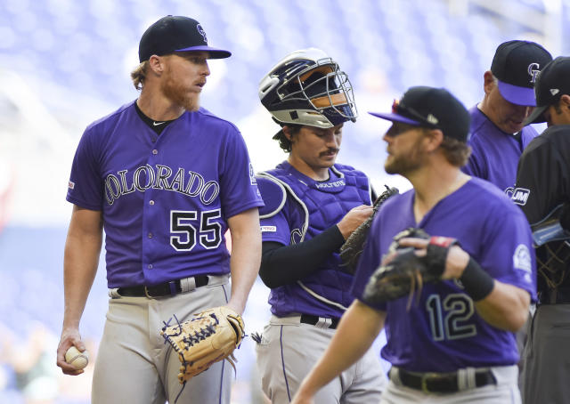 Colorado Rockies' pitcher Jon Gray is taken out due to a right calf cramp during the seventh inning of a baseball game against the Miami Marlins, Sunday, March 31, 2019, in Miami. The Marlins won 3-0. (AP Photo/Gaston De Cardenas)