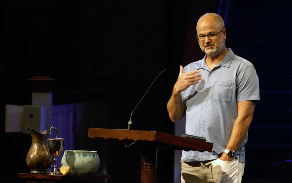 In this Aug. 23, 2020, photo provided by Steve NeSmith, Scott Sauls, senior pastor at Christ Presbyterian Church, preaches to his congregation in Nashville, Tenn. (Steve NeSmith/Christ Presbyterian Church via AP)