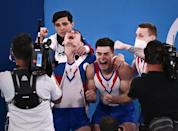 <p>The male gymnasts from Russia celebrate their artistic gymnastics gold medal win on July 26.</p>