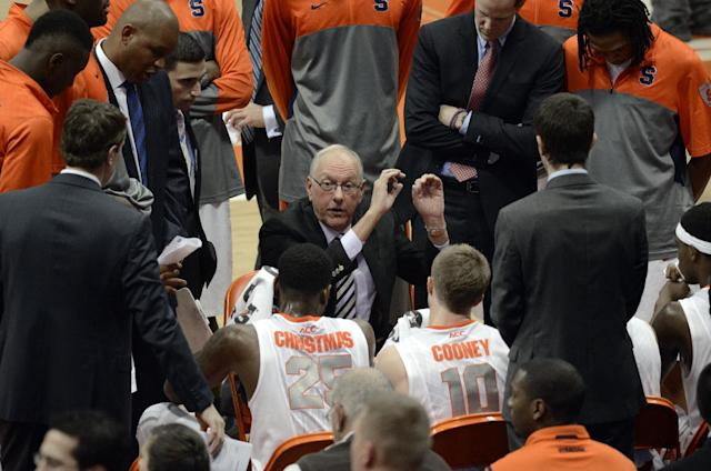 Syracuse head coach Jim Boeheim talks with his players during a time out against Indiana during the second half of an NCAA college basketball game in Syracuse, N.Y., Tuesday, Dec. 3, 2013. Syracuse won 69-52. (AP Photo/Kevin Rivoli)