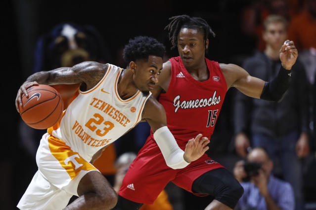 Tennessee guard Jordan Bowden (23) drives against Jacksonville State guard Derek St. Hilaire (15) during the second half of an NCAA college basketball game Saturday, Dec. 21, 2019, in Knoxville, Tenn. Tennessee won 75-53. (AP Photo/Wade Payne)