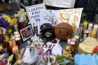 A memorial near Staples Center after the death of Laker legend Kobe Bryant Sunday, Jan. 26, 2020, in Los Angeles. (AP Photo/Michael Owen Baker)
