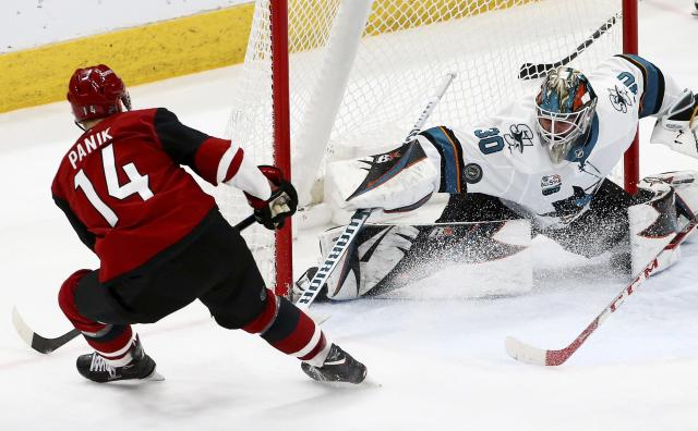 San Jose Sharks goaltender Aaron Dell (30) makes a save on a shot by Arizona Coyotes right wing Richard Panik (14) during the second period of an NHL hockey game Wednesday, Jan. 16, 2019, in Glendale, Ariz. (AP Photo/Ross D. Franklin)