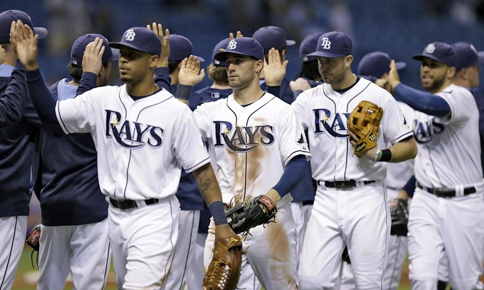 Tampa Bay Rays players celebrate after the team defeated the Seattle Mariners 4-0 during a baseball game Friday, June 6, 2014, in St. Petersburg, Fla.