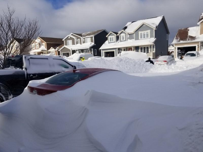 Snow covers cars in Paradise