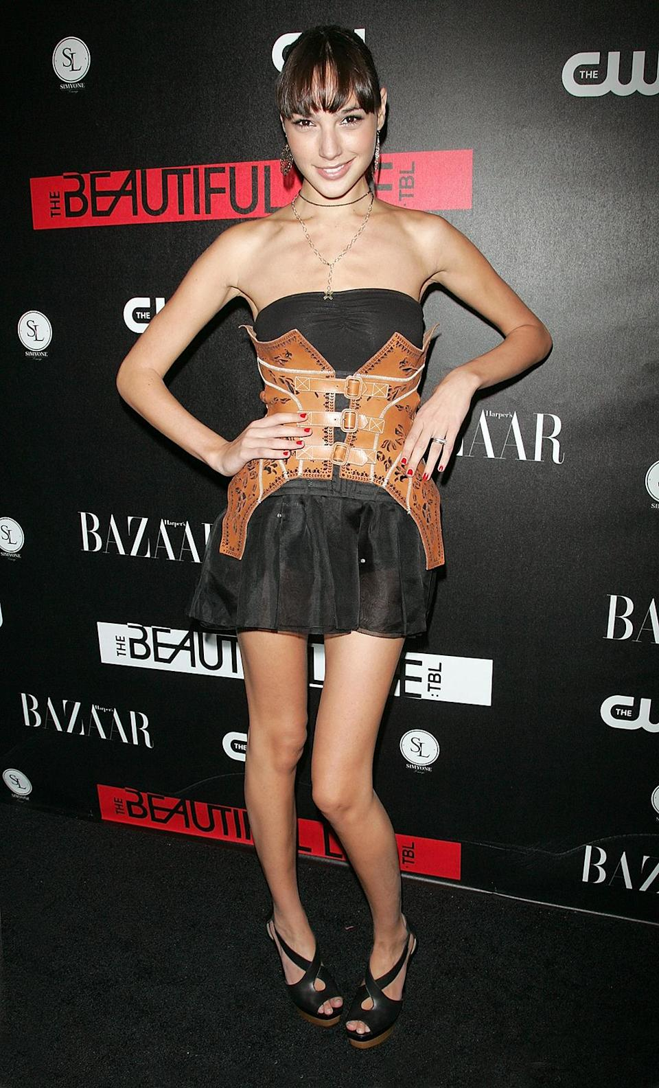 <p>Gadot starred as a model in the short-lived TV series The Beautiful Life: TBL , produced by Ashton Kutcher . (Photo: Jim Spellman/WireImage) </p>