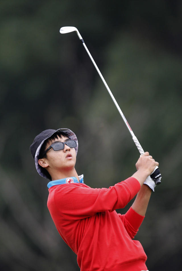 Dou Zecheng of China swings on the 11th hole during the final round of the HSBC Champions golf tournament at the Sheshan International Golf Club in Shanghai, China, Saturday, Nov. 9, 2014. (AP Photo)