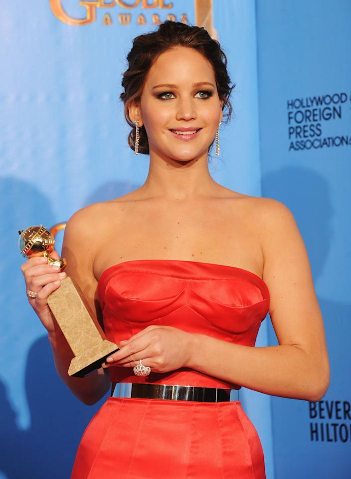 Jennifer Lawrence poses with Best Actress in a Comedy or Musical Award in the press room during the 70th Annual Golden Globe Awards held at The Beverly Hilton Hotel on January 13, 2013 in Beverly Hills, California.
