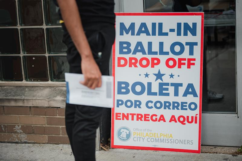 A voter waits to drop off his mail-in ballot at West Oak Lane Library in Philadelphia, Pennsylvania, U.S., on on June 2, 2020. (Hannah Yoon/Bloombergvia Getty Images)