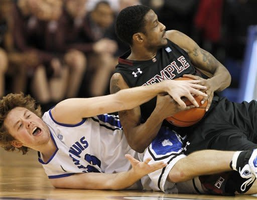 Saint Louis' Kyle Cassity, left, and Temple's Ramone Moore fight over a loose ball during the second half of an NCAA college basketball game Wednesday, Jan. 11, 2012, in St. Louis. Temple won 72-67. (AP Photo/Jeff Roberson)