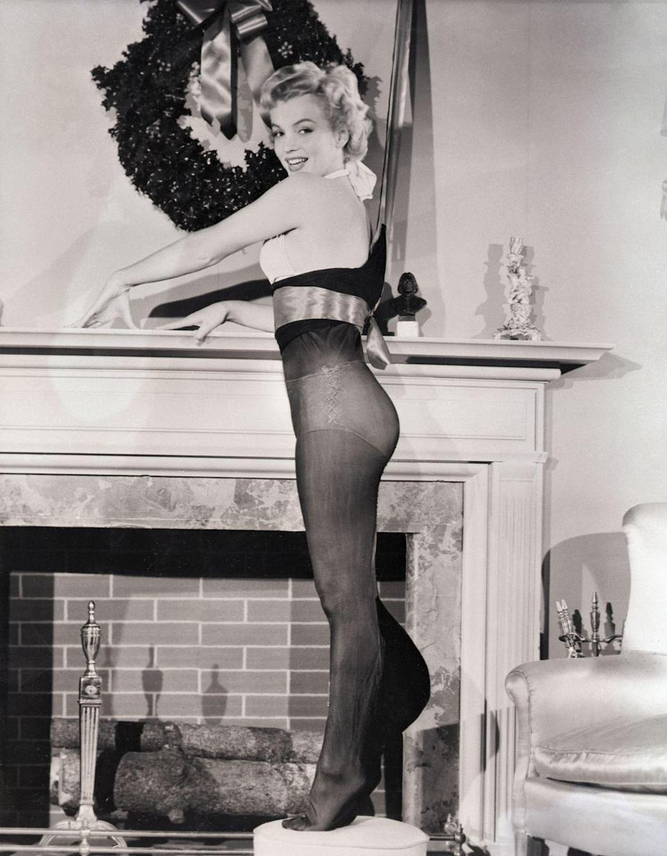 "<p>Marilyn Monroe poses in stockings next to a festive fireplace after being <a href=""https://books.google.com/books?id=M2M-DwAAQBAJ&pg=PT51&lpg=PT51&dq=marilyn+monroe+the+Present+all+GI%27s+would+like+to+find+in+their+Christmas+stocking&source=bl&ots=Kcb96VE854&sig=ACfU3U3mMYXJ7PstQqN9fDRRwlj91MuXzg&hl=en&sa=X&ved=2ahUKEwinw7mFrZrmAhVkneAKHfD2DooQ6AEwEHoECAkQAQ#v=onepage&q=marilyn%20monroe%20the%20Present%20all%20GI's%20would%20like%20to%20find%20in%20their%20Christmas%20stocking&f=false"" rel=""nofollow noopener"" target=""_blank"" data-ylk=""slk:voted"" class=""link rapid-noclick-resp"">voted</a>, ""the present all GI's would like to find in their Christmas stocking."" Clever!</p>"